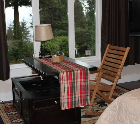 lift top table in bedroom makes for lovely seating in front of ocean/forest  view window