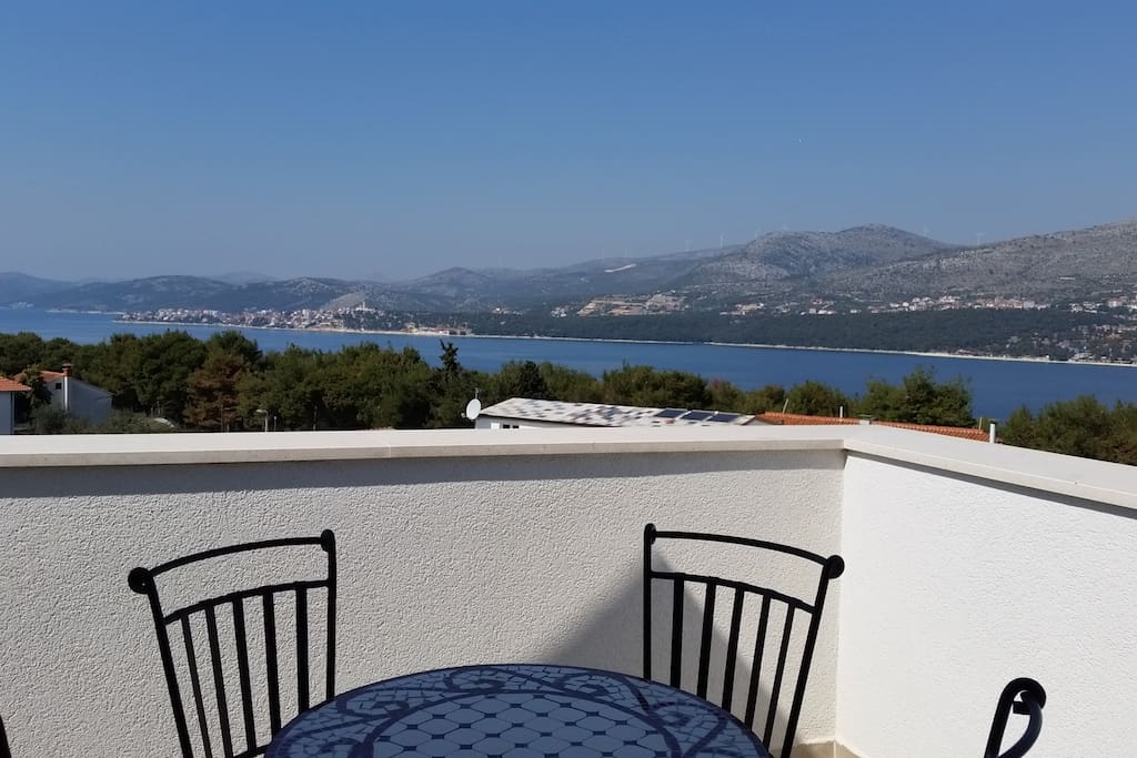 The panoramic sea view from terrace on the roof with outdoor seating