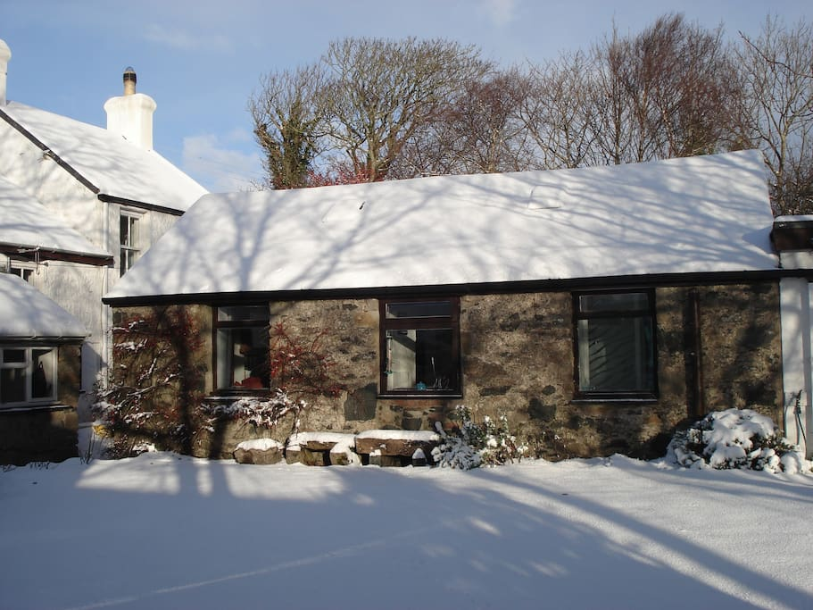 Stick Cottage in the snow