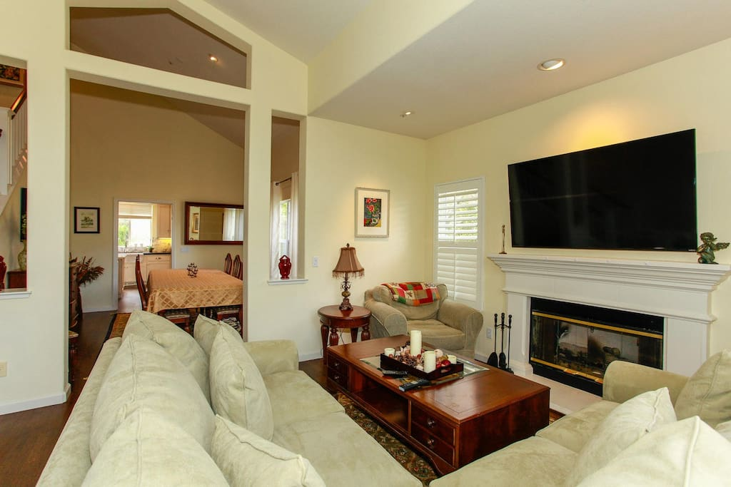 Living room with fireplace and huge flatscreen TV