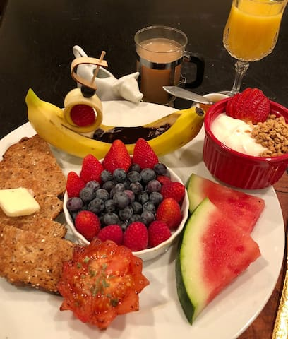 Seasonal fruit platter with banana boat (can be filled with heated chocolate--go ahead, indulge yourself and go overboard).