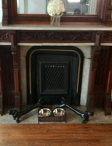 Hand carved floor to ceiling mantle in living room
