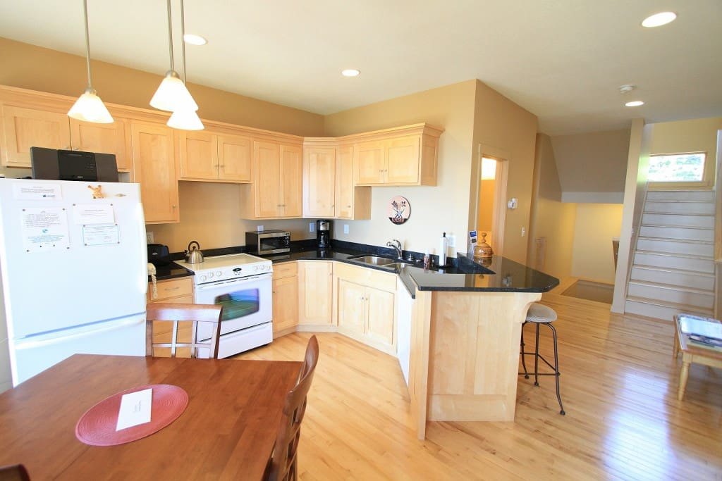 The granite counter tops, full sized appliances, and great Lake Superior views make this kitchen the perfect place to prepare your meals.