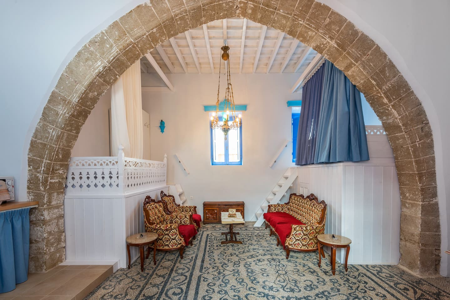 Louloudi Traditional House. Amazing atmosphere of this house, which was lately renovated but still keep original features like pebble floor, high ceiling, two double beds elevated on the sides of the main room.