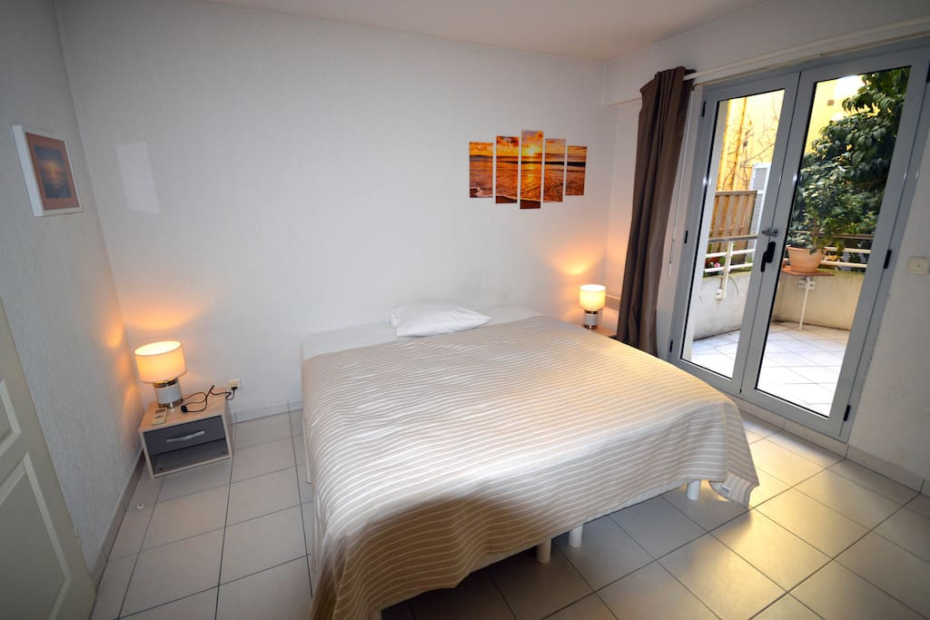 1st Bedroom, opening on a terrace, with a queen size bed that can be divided into 2 single beds at your convenience