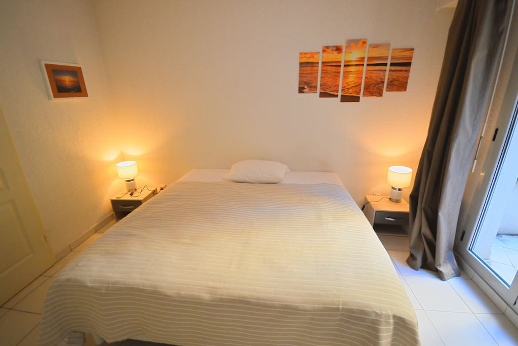 1st Bedroom, opening on a terrace, with a queen size bed which can be divided into 2 single beds at your convenience