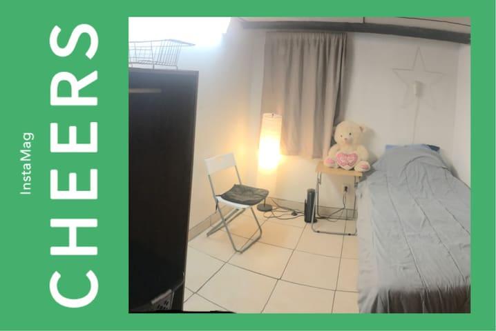 Private small room in half basement apartment