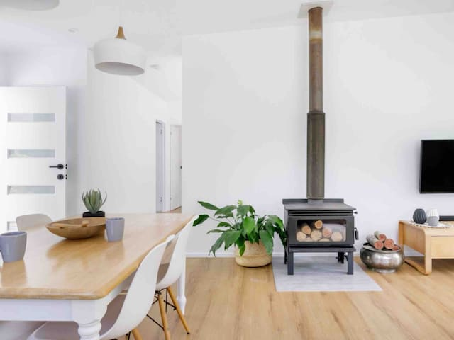 Stylish scandi inspired decor and a warm cosy fireplace.