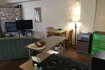 Kitchenette, kitchen table and TV area.