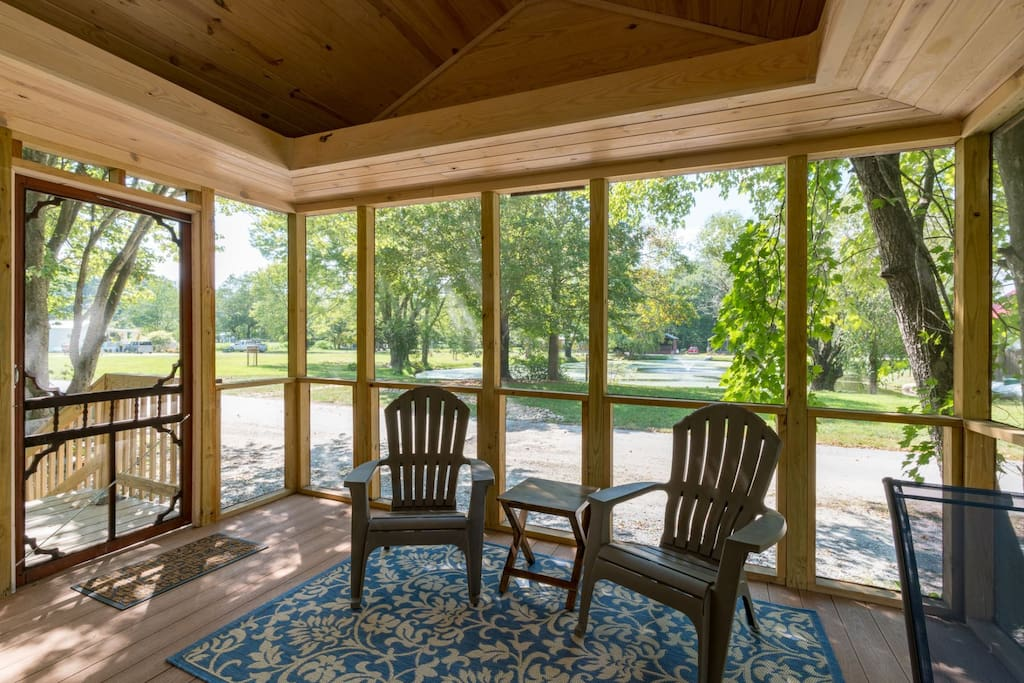 Over sized screened deck overlooks lake