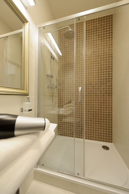 A spacious rainfall shower, perfect for relaxing after a long day full of adventures.