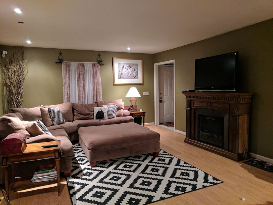 Warning: you WILL fall asleep on this sectional... Super comfy!  Electric fireplace, flat screen TV, can lighting or lamp lighting depending on your mood.