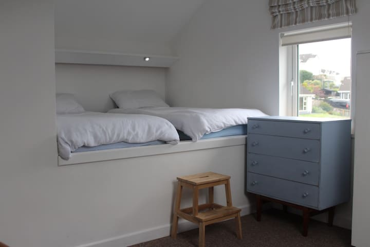 Upstairs Bedroom 3 (3 single beds) - please note steps up