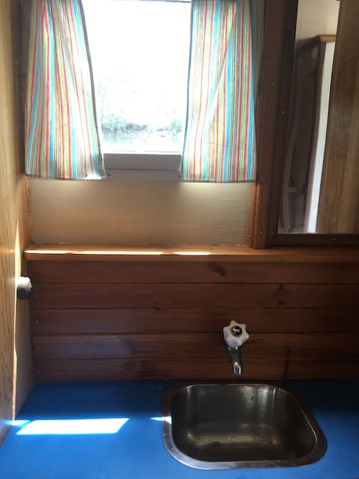 Gas stove, hot and cold running water, plenty of cupboard space and a cute shower completes the picture...