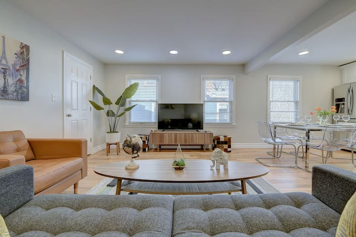 Comfortably furnished living room with a coffee table, 52-inch Smart TV, and TV stand with storage.