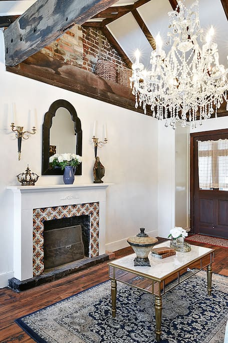 Original fireplace and antique mirror and furnishings