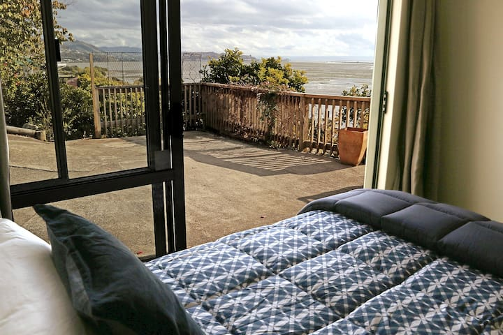 Room on the lower floor, massive sliding doors with views over the water to Nelson City.