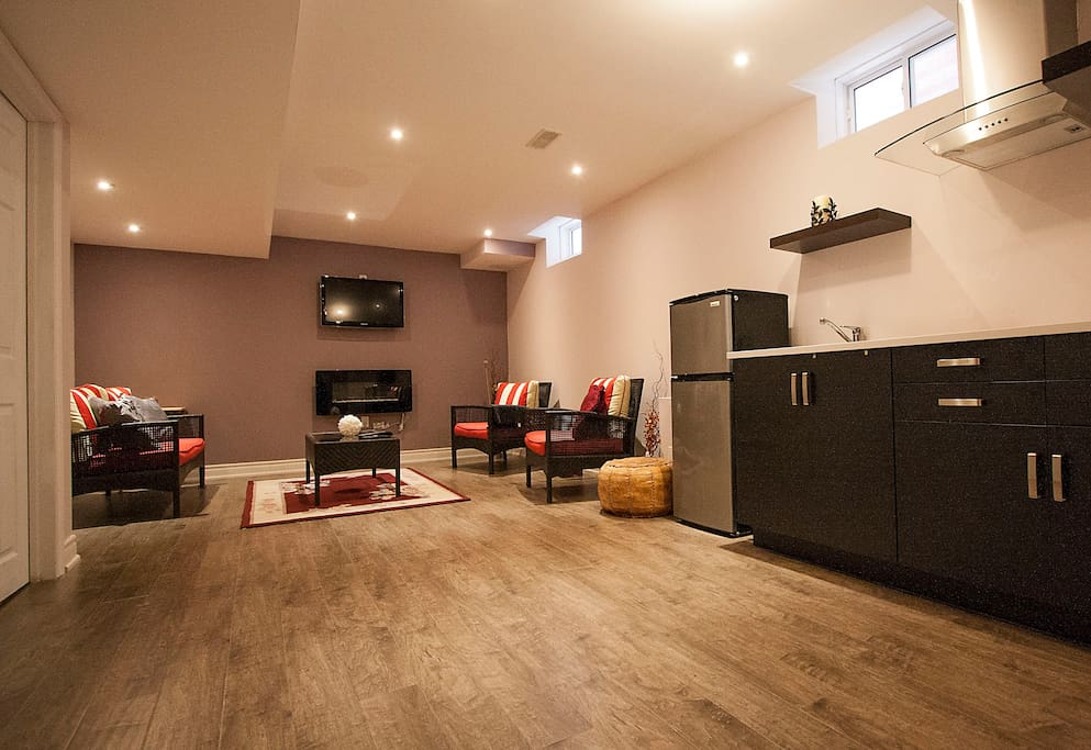 Private spacious living room with a fire place and Apple TV