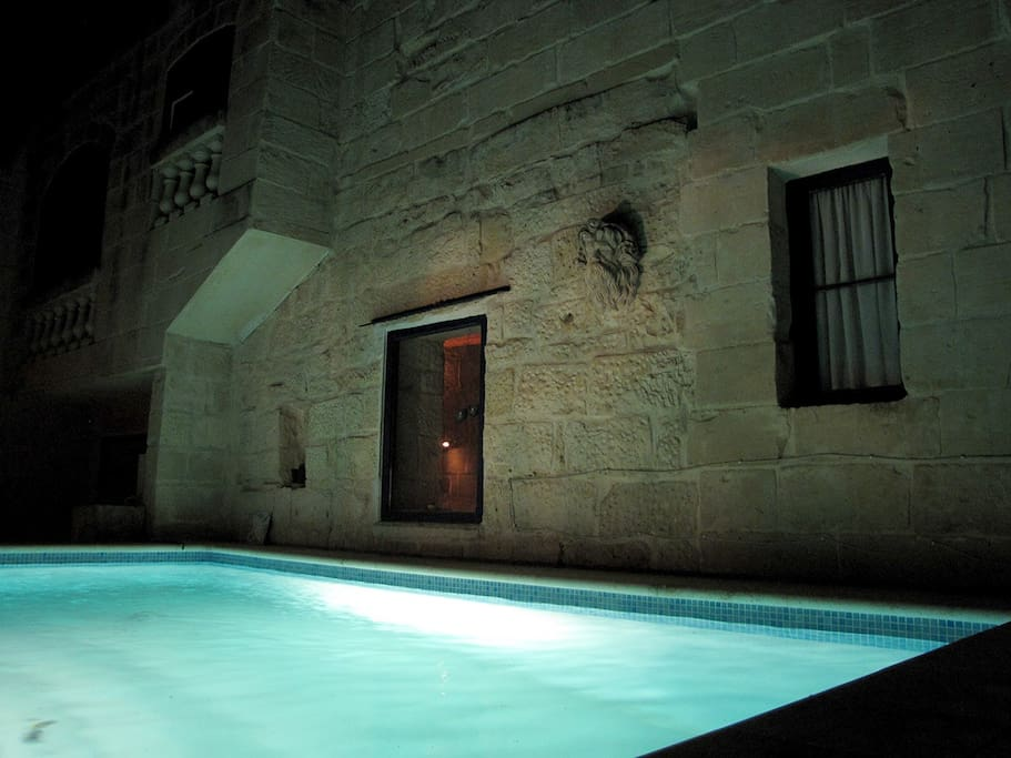 Pool illuminated at night.