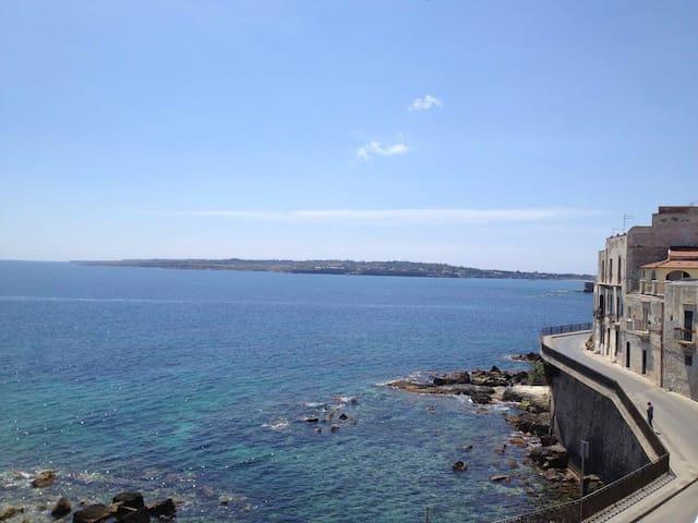 Luxury seafront terrace in Ortigia.
