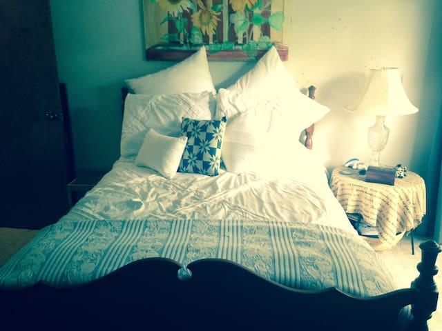 Cozy Bedroom with a Balcony