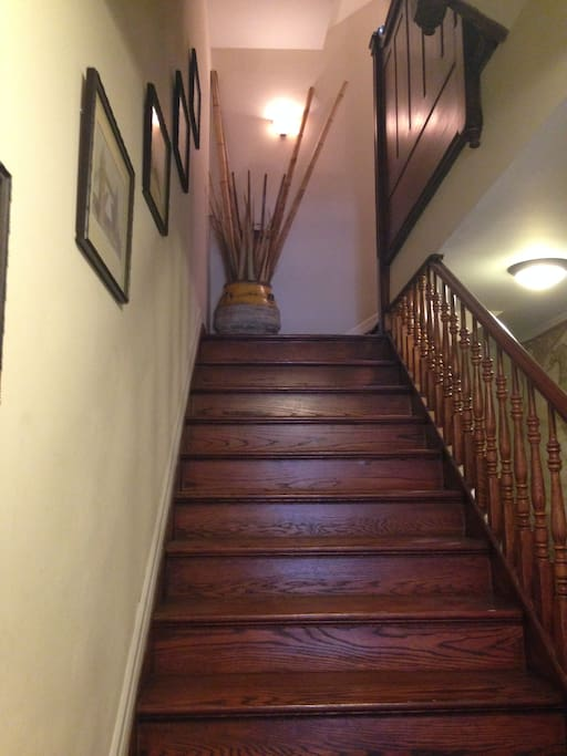 Staircase leading to 2nd floor rental apartment.