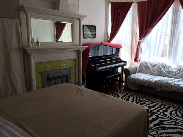 A Cozy Victorian Room with a Piano