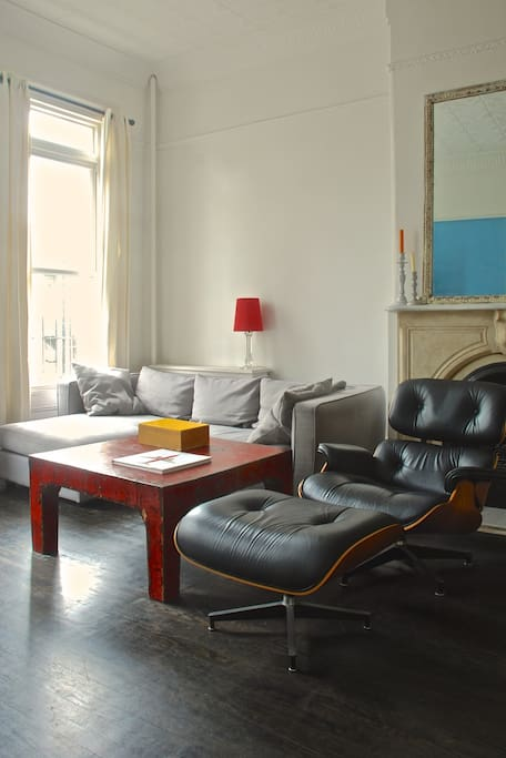 Sectional sofa and Eames Lounge Chair and Ottoman for family TV/movie viewing