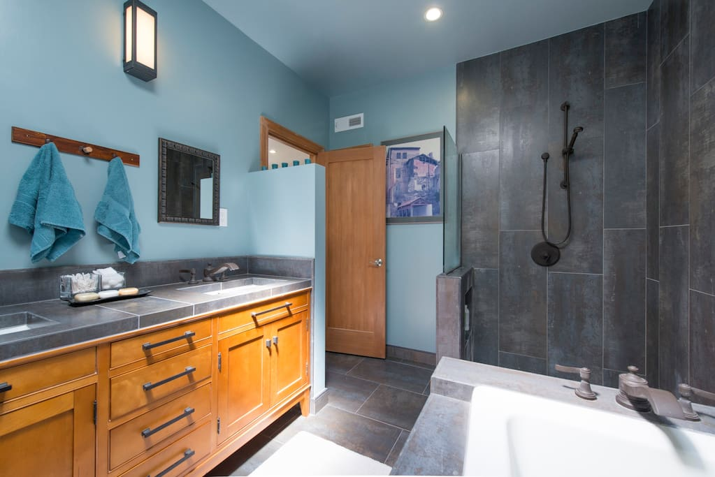 Ensuite bathroom with modern standing shower, soaking bathtub, and pottery barn double sink vanity