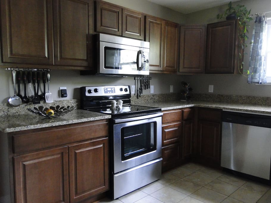 Fully equipped kitchen with rice cooker, blender, slow cooker, toaster, coffee maker, etc.