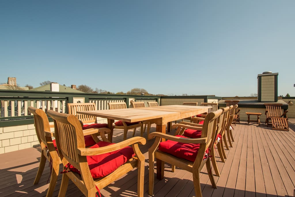 Roof deck with seating for 12 and Newport bridge and harbor views