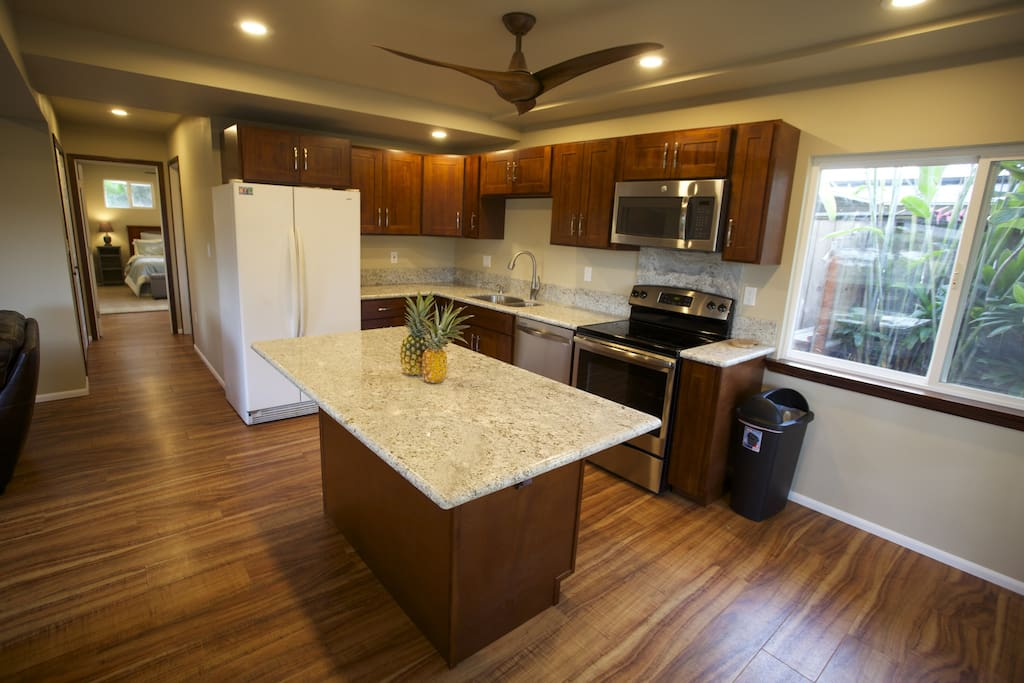 Fully equiped kitchen. granite countertops, new appliances, bright and airy kitchen. Island seating.