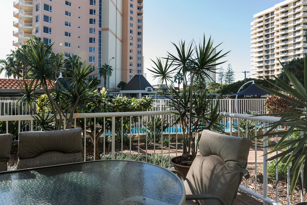 enjoy a a casual drink on the patio overlooking the swimming pool