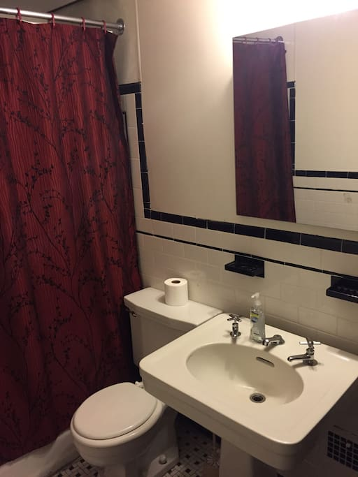 Full size bathroom between rooms which is private to the suite.
