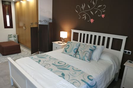 Habitación privada con cocina y baño Compartido