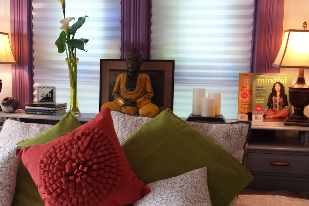 Buddha presides over peaceful master bedroom