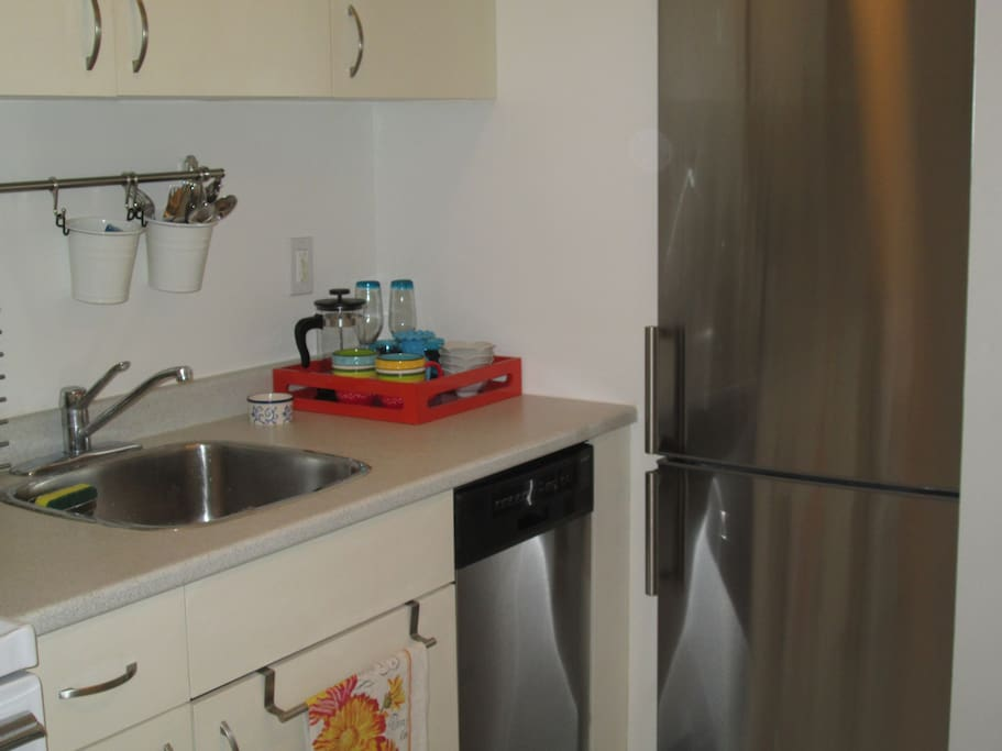 kitchen separated from sleeping and living areas, completely outfitted ,small but perfect, lovely dishes,  practical yet attractive glasswear, pots and pans, etc! Brand new stainless steel bottom mount fridge and dishwasher!