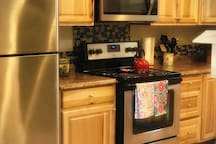 Newly remodeled Hickory kitchen, complete with stove, oven, microwave and refrigerator