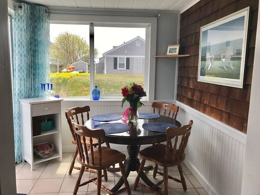 Breakfast nook off of kitchen, sliders to back deck
