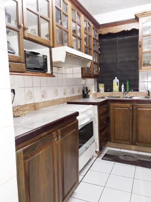 Modern Kitchen equipped with all cooking utensils, fridge, toaster, and stove and oven for your use