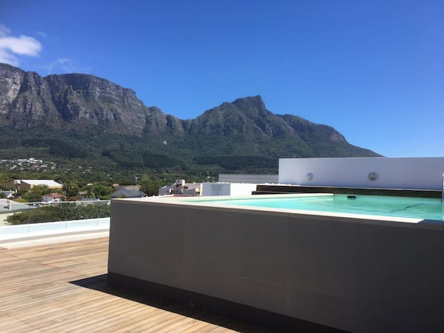 The upper deck has a rooftop pool with beautiful views of Cape Town's famous mountains. The pool is used by all residents of the apartment block and is not for your sole use.