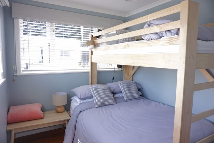 Single bed on top with a double bed below.