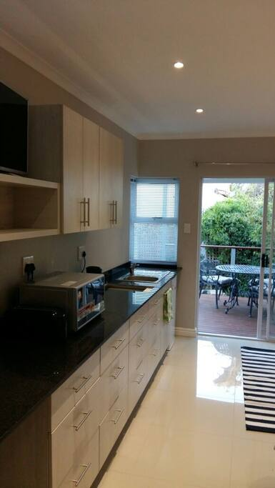full kitchen with fridge, combo microvave, gas hob
