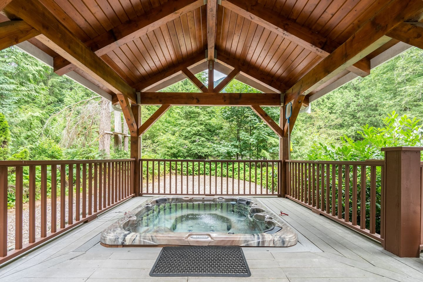 Soak in our 7 seater luxury Dimension 1 hot tub under our gazebo.
