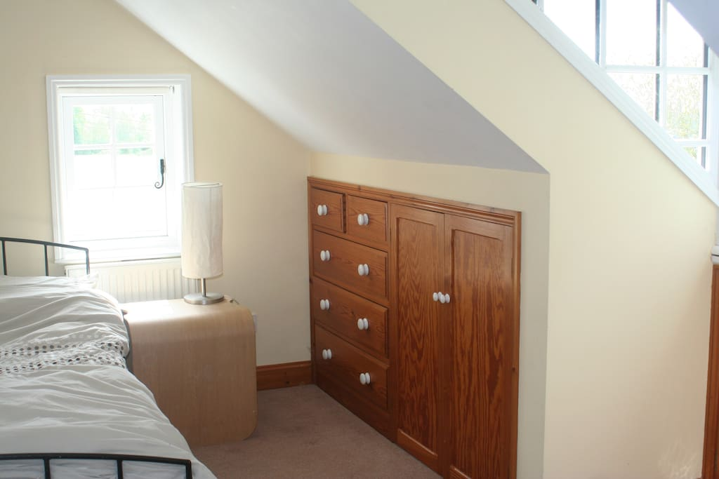 Comfortable double bed in spacious, light and airy loft.