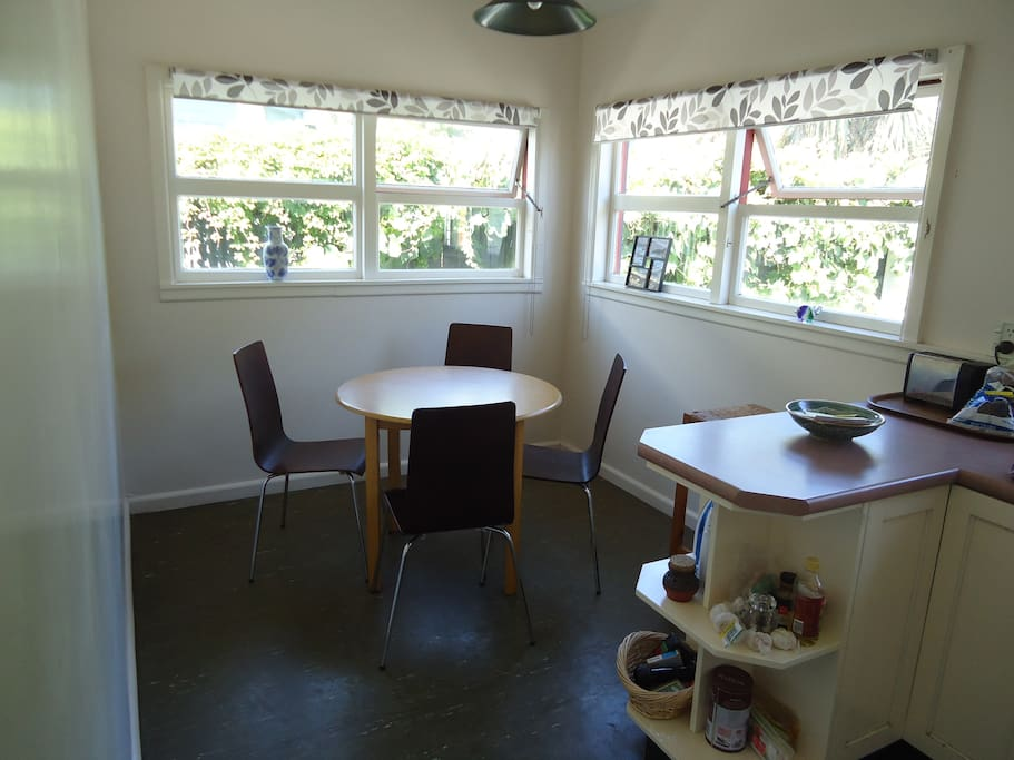 Sunlit dining area beside the kitchen, which you are welcome to use to prepare your meals.