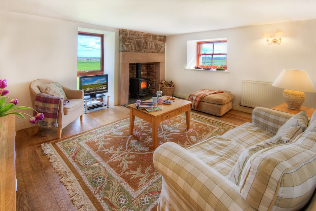 Sitting room, Garden Cottage, Scottish Borders - with lovely log-burning stove and views of the surrounding countryside.