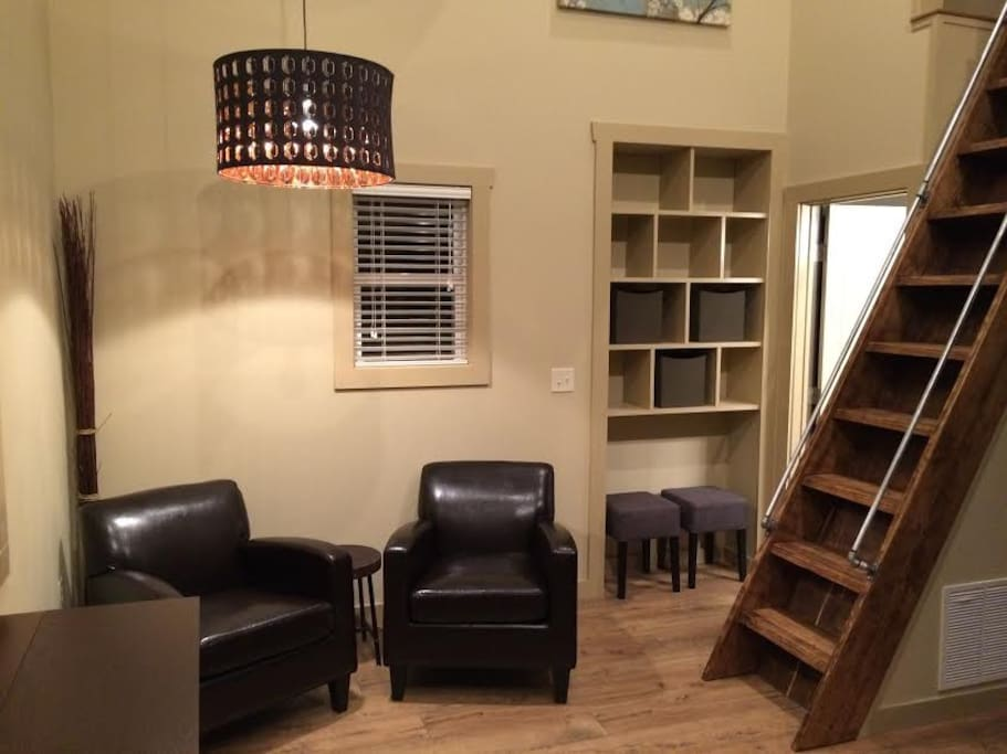 """Downstairs living area.  Includes drop leaf dining table and 32"""" wall mounted smart TV."""