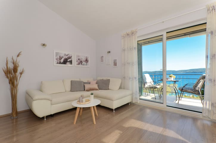 Living area Mar deLuxe apartment no.3 with beautiful sea view and view to the islands. Only 30 m from the beach.
