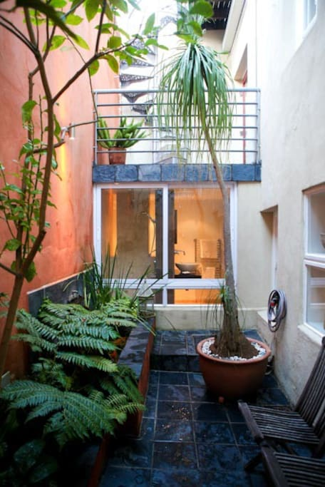 Private Courtyard with fish pond and outside shower